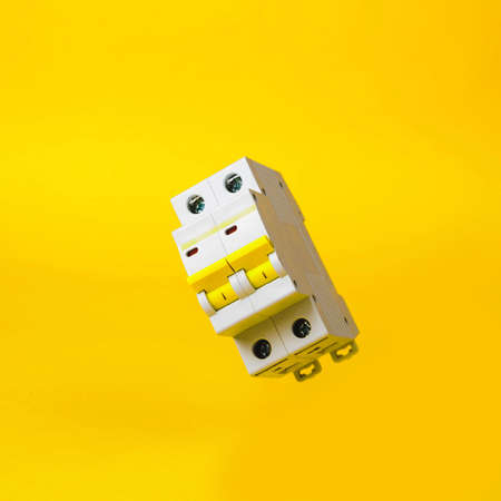 The circuit breaker on a yellow background
