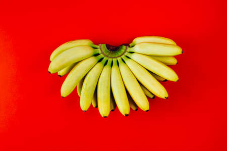 Banana isolated on red background. Flat lay and top view Stockfoto