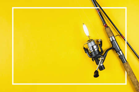 Spinning and tackle on yellow background