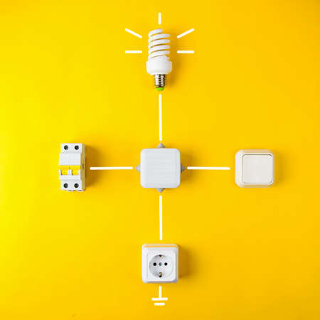 Components for wiring on yellow background Stock Photo
