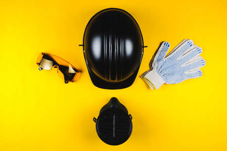 Personal protective equipment on yellow background Stockfoto