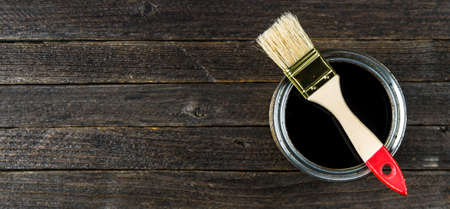 Lacquer jar and brush on wooden background