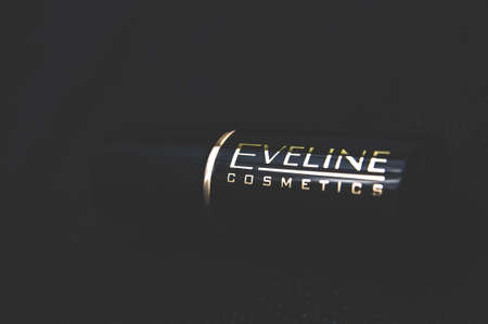 Russia, Moscow, October 02, 2019: Eveline Cosmetics logo and text lipstick on a dark background