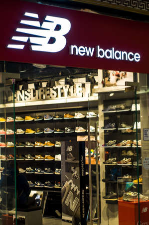 Russia, Moscow, October 10, 2019: New Balance logo on the shop window