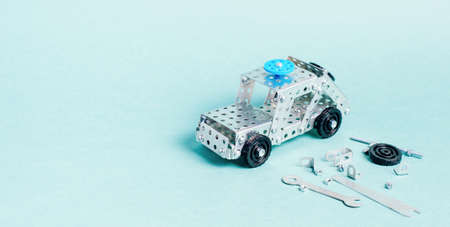 Childrens designer in the form of a police car on a green background, a place for text or design Imagens