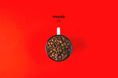 Cup with coffee grains and the text Power on on an red background