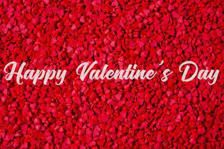 Background of red hearts and text Happy Valentines Day Imagens