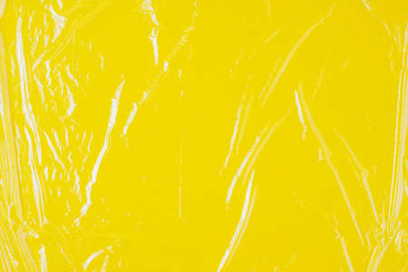 Transparent cellophane texture on an yellow backing