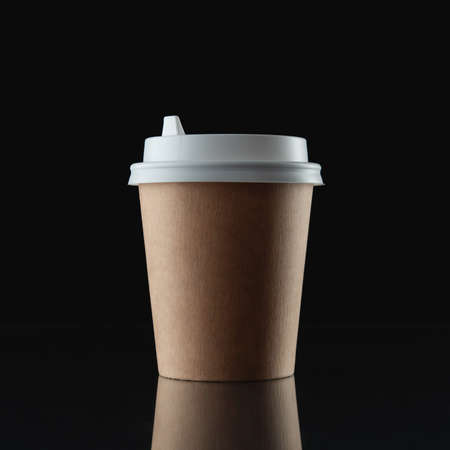 Paper cup for coffee on a black background. Template for text or design Reklamní fotografie