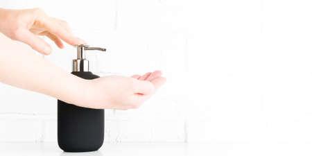 Woman washing hands with antibacterial soap. Personal hygiene to stop spreading coronavirus Banco de Imagens