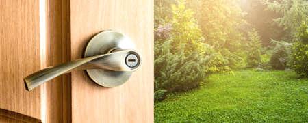 Open door with view of the garden Banco de Imagens