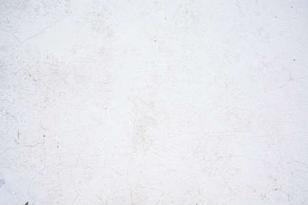 Texture of old cracked paint on the wall. White background for text or design Banco de Imagens