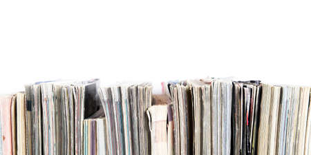 A stack of old magazines on a white background. Space for text or design