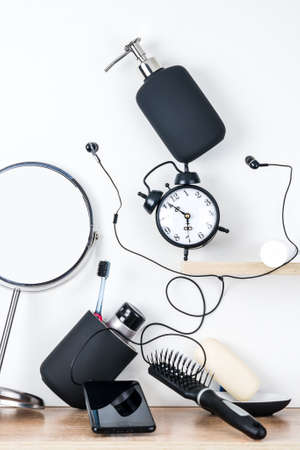 Morning hygiene supplies are scattered in disarray on a white background. The concept of the morning hustle and bustle