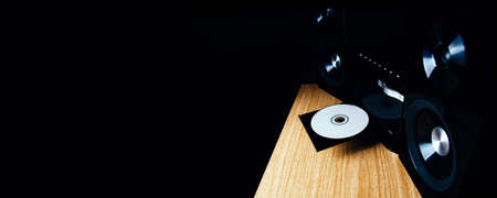 Modern CD player on a dark background. Space for text or design