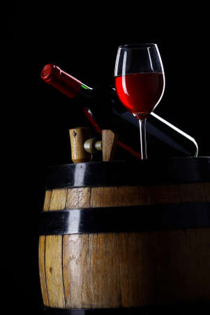 Bottle and glass of wine in black Stock Photo