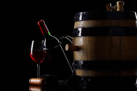 Bottle and glass of wine in black Stock Photo - 16776851
