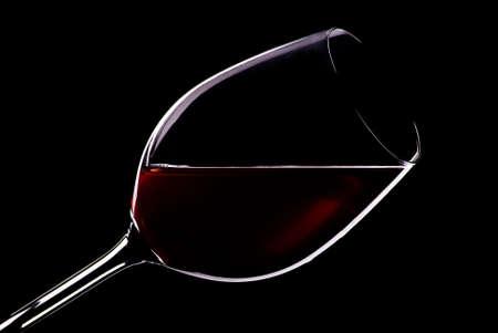 Glass of wine in black Stock Photo