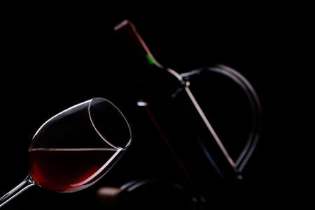 Glass and  bottle  wine in black