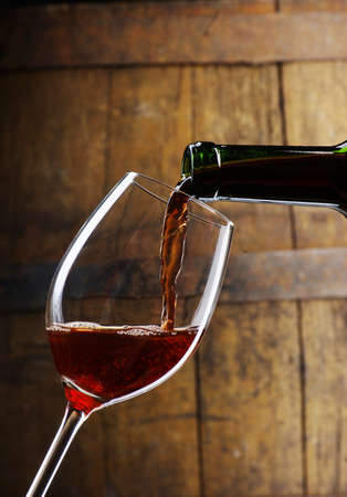 wine barrel: glass of wine with barrel Stock Photo
