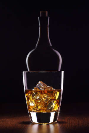 glass whiskey with bottle