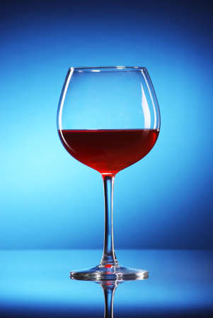 glass of wine in blue