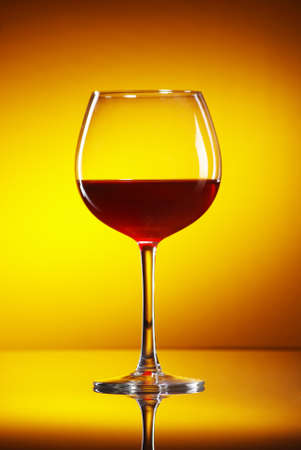 glass of wine in yelow