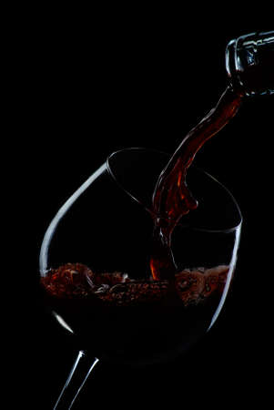 wine and food: glass  red  wine  on  black