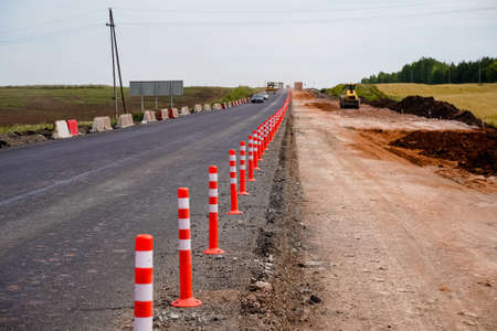 laying of new asphalt, road repairs, highways, road works, gravel, protective fences, marking, going into the distance, old and new, without people