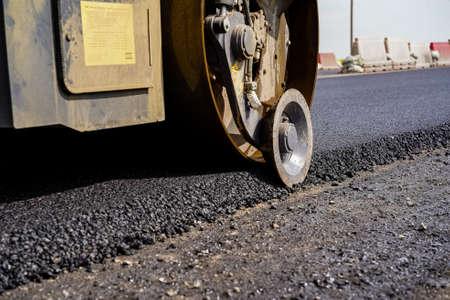 road equipment lays asphalt, road works, paver, road repairs