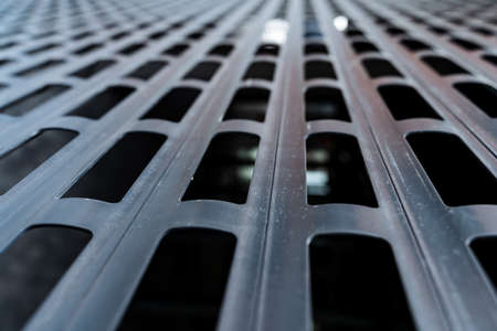 black grid with large cells, background image, blurred background, close-up shutters, gates, macro photography, abstraction