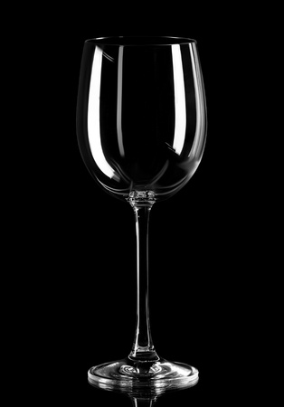 Close up of empty wine glass isolated on black background