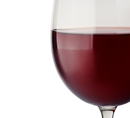Close-up of red wine and glass focus on the rim.  photo