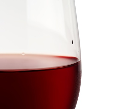 Close-up of red wine and glass focus on the rim  photo