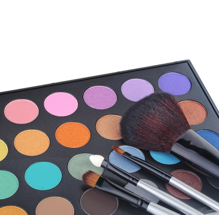 eyeshadow kit for make-up over white background  photo