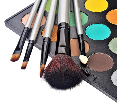 makeup artist: makeup brush and cosmetics, on a white background isolated
