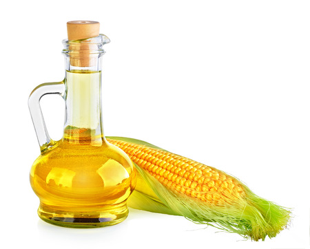 Bottle with oil and a corncob. On white background. Stock Photo