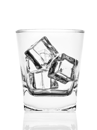 bar ware: Glass of ice cubes isolated on white background
