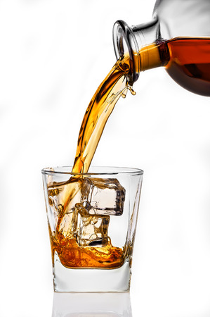 whisky glass: whiskey being poured into a glass