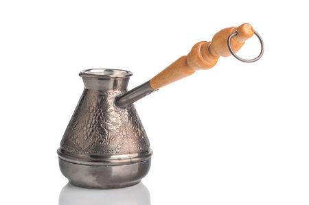 turk: Copper Turk to brew coffee on a white background