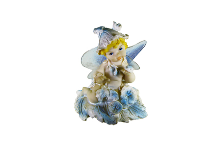 Toy figure fairy in a hat with wings