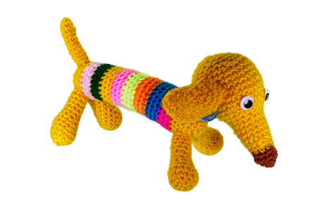 Yellow dog of an amigurumi knitted a hook from yarn
