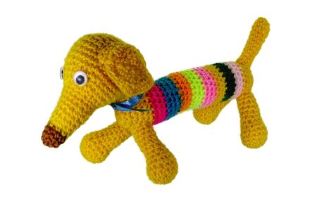 Crocheted multi-colored dog with a long nose Banco de Imagens
