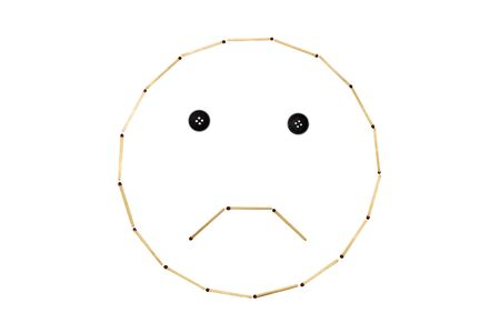 Smiley face sadness is made out of matches