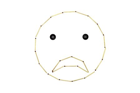 Smiley face disappointment is made out of matches