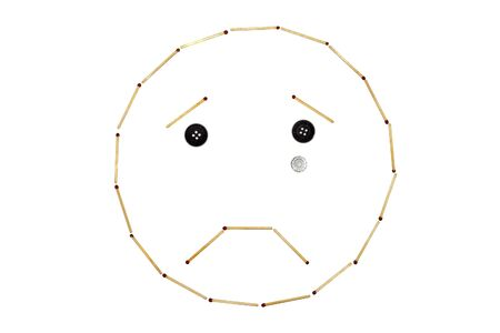 Smiley expressing emotion Crying is made of matches on a white background