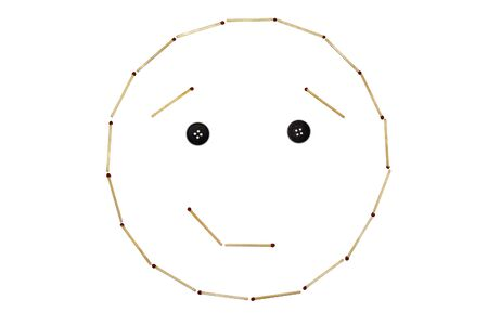 Smiley expressing emotion Smirk is made of matches on a white background Banco de Imagens