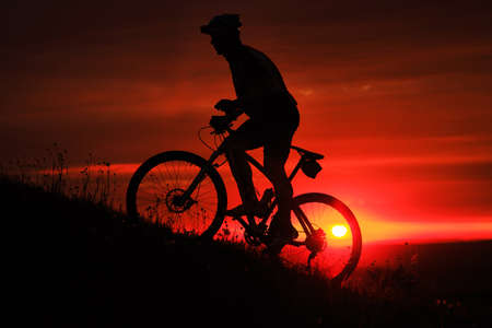 Silhouette of a bike on sky background on sunset Stok Fotoğraf - 42990058