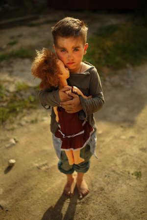 alone sad child playing on a street