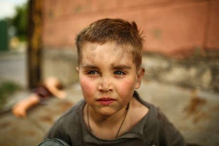 alone: alone sad child playing on a street